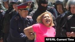 Kazakhstan -- Police arrest a demonstrator in Almaty May 21.