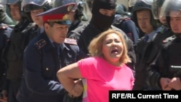 Kazakhstan -- Police arrest a demonstrator in Almaty May 21.