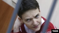 Savchenko sits inside a defendants' cage as she attends a court hearing in Moscow on March 4.