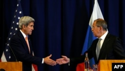 Switzerland -- US Secretary of State John Kerry and Russian Foreign Minister Sergei Lavrov shake hands at the conclusion of their press conference following their meeting in Geneva where they discussed the crisis in Syria,September 9, 2016