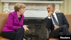 U.S. President Barack Obama (right) met at the White House on February 9 with German Chancellor Angela Merkel to discuss the crisis in Ukraine.