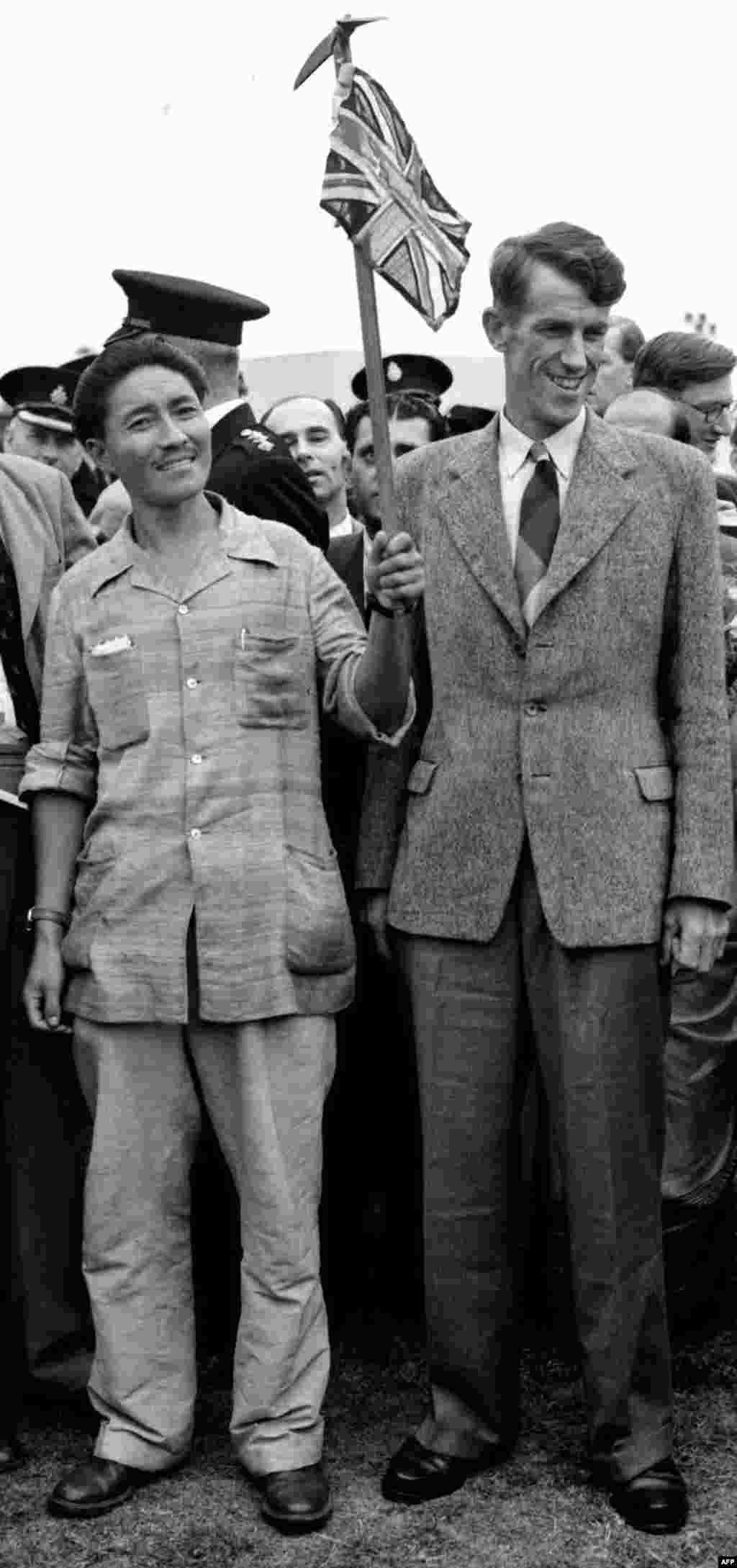 A photo from July 3, 1953, shows pioneering Mount Everest climbers Edmund Hillary of New Zealand and Tenzing Norgay of Nepal in London after their expedition.