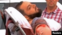 New York bombing suspect Ahmad Khan Rahami is loaded into an ambulance after a shoot-out with police in Linden, New Jersey, on September 19.