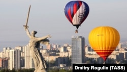 In Volgograd, hot-air balloons float by the Motherland Calls monument commemorating the Battle of Stalingrad.