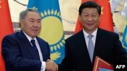 Қазақстан президенті Нұрсұлтан Назарбаев пен Қытай президенті Си Цзиньпин.