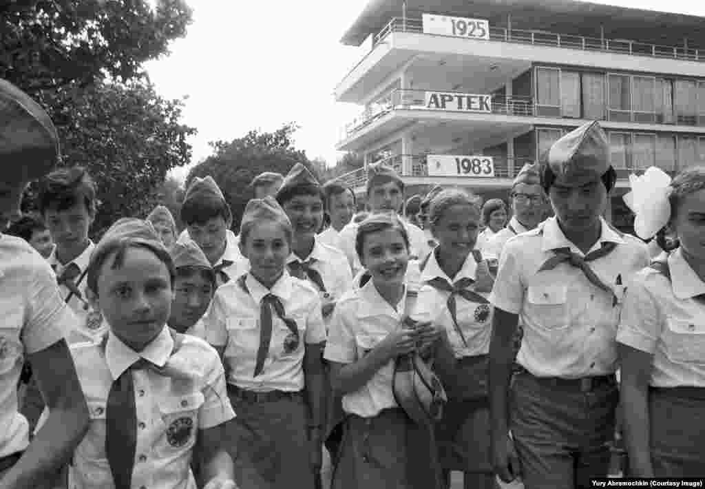 American peace activist Samantha Smith (center, with satchel) in Crimea in 1983 as photographed by Abramochkin. The young American girl became famous after exchanging letters with the Soviet leader at the time and receiving a personal invitation to visit the U.S.S.R. Two years after this photo was taken she was killed in a plane crash in Maine.