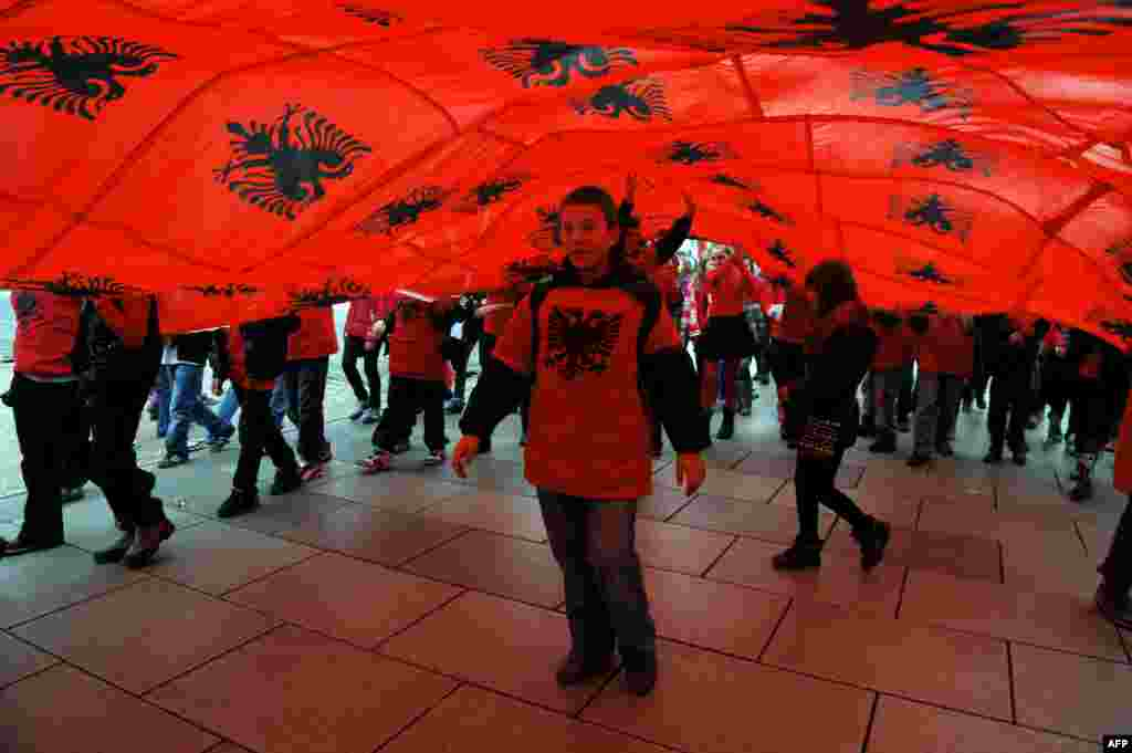 Ethnic Albanian children march under Albanian flags in Pristina, Kosovo, during celebrations of the 100th anniversary of Albania's declaration of independence on November 28. (AFP/Armend Nimani)
