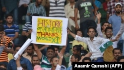 Pakistani spectators cheer at the start of the first Twenty20 international match between the World XI and Pakistan at the Gaddafi Cricket Stadium in Lahore on September 12.