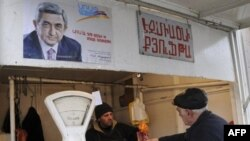 A butcher shop in Yerevan, under the watchful gaze of President Serzh Sarkisian.