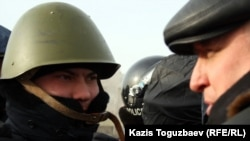 Police have raided the home of opposition leader Vladimir Kozlov (pictured right)