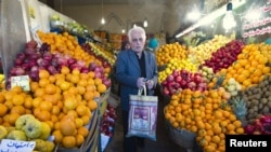 Iran -- A man leaves after shopping at a fruit store in Tehran, 06Jan2012