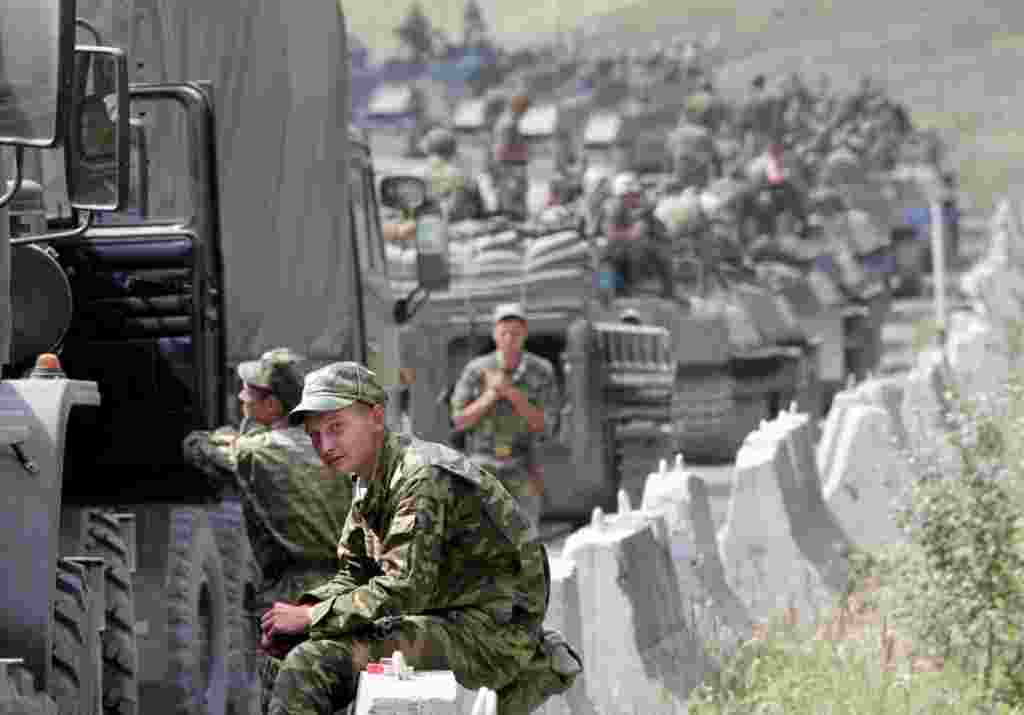 Russian soldiers take a break as they approach Tskhinvali on August 9.