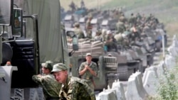 Russian soldiers pause on their way to Tskhinvali, South Ossetia, at the start of the August, 2008, conflict.