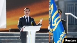 In a speech before thousands of flag-waving Ukrainians, Zelenskiy also vowed that areas of eastern Ukraine under Russia-backed separatist control would be governed again by Kyiv.