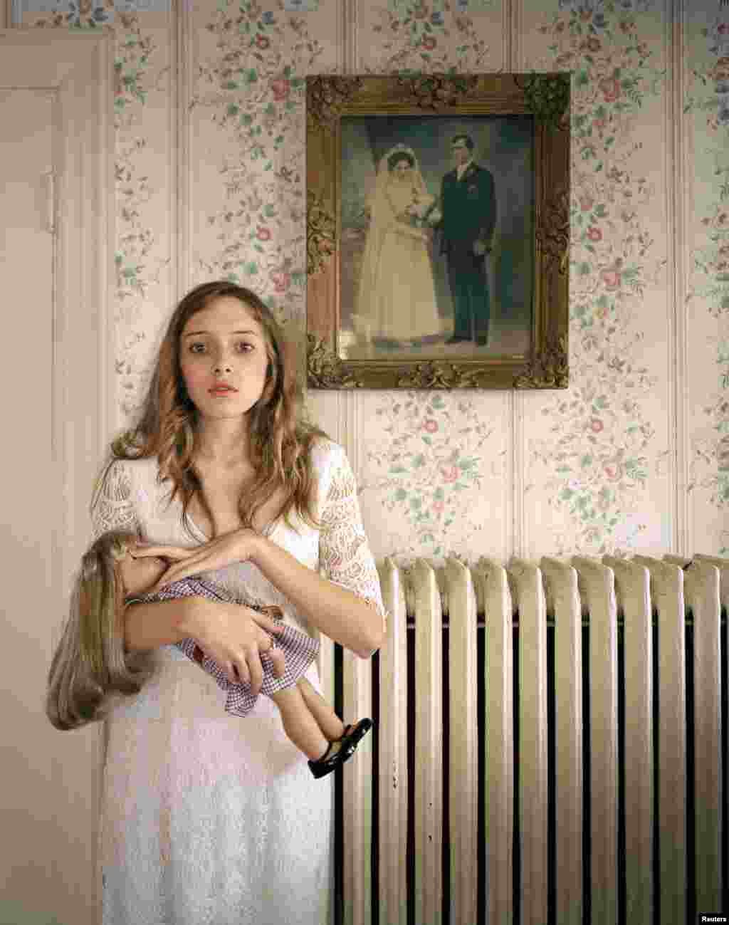Ilona Szwarc of Poland, a photographer working for Redux Images, won third prize in the People -- Observed Portraits Single category with this picture of Kayla posing with her lookalike doll in front of a portrait of her ancestors in Boston, Massachusetts.