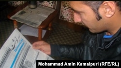 Afghanistan – An Afghan man read an Afghan newspaper for updating himself from a world situation on 10Jan2011