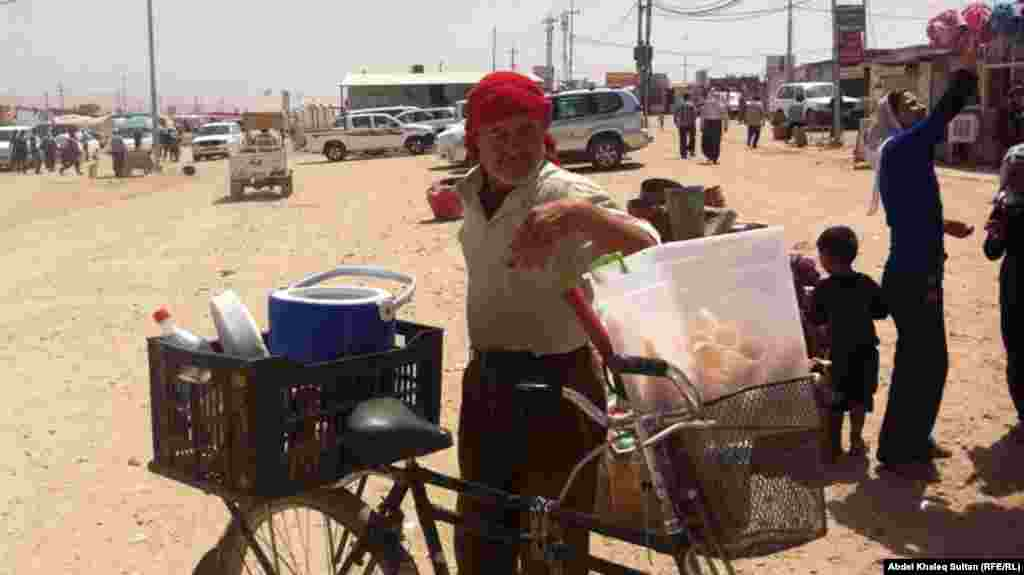 A man sells ice cream in the Domeez camp.