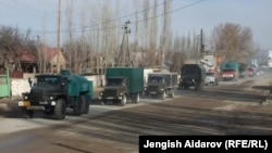 A group of trucks with relief supplies from Uzbekistan to the Sokh exclave arrive at a checkpoint.