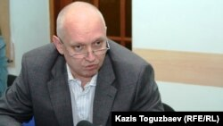 Vladimir Kozlov, leader of the opposition party Algha, talks to the press in Almaty.