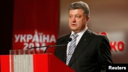 Ukraine -- Ukrainian businessman, politician and presidential candidate Petro Poroshenko speaks to supporters at his election headquarters in Kiev May 25, 2014. An exit poll on Sunday indicated that Ukrainian confectionery tycoon Poroshenko was elected p