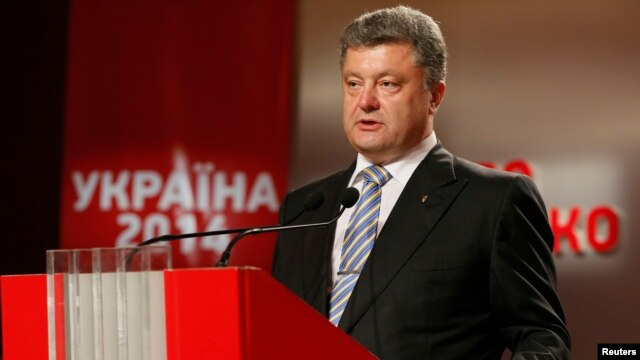 Ukrainian businessman, politician, and presidential candidate Petro Poroshenko declared victory in front of supporters at his election headquarters in Kyiv on May 25.