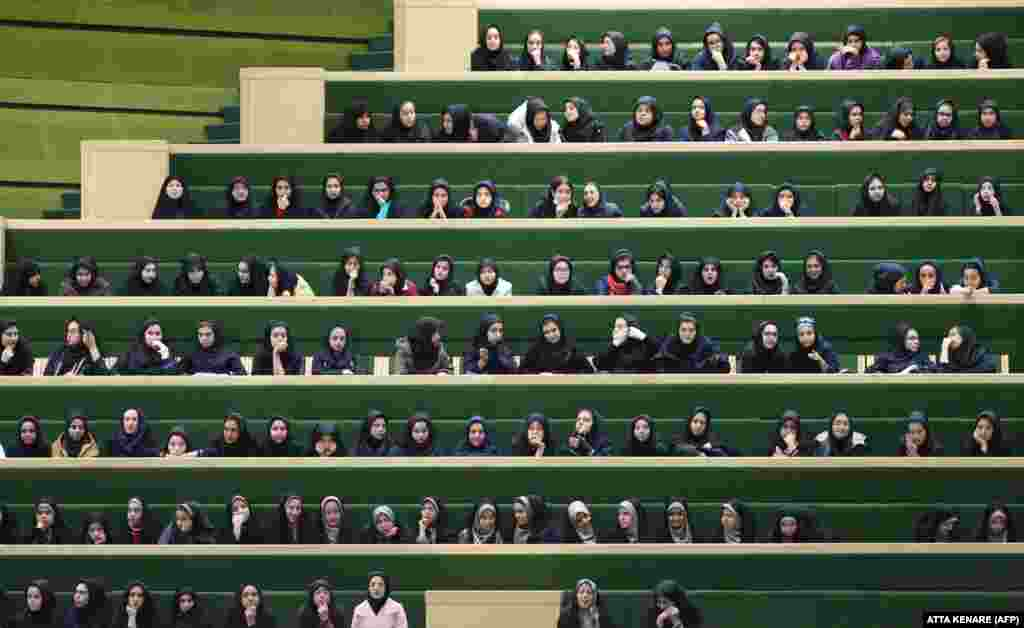 Iranian school girls listen to a speech by President Mahmud Ahmadinejad at a parliamentary session in Tehran on February 3.