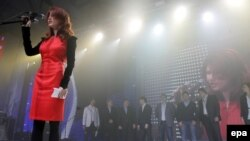Accused Russian spy Anna Chapman onstage to address the pro-Kremlin Young Guard movement in Moscow on December 22