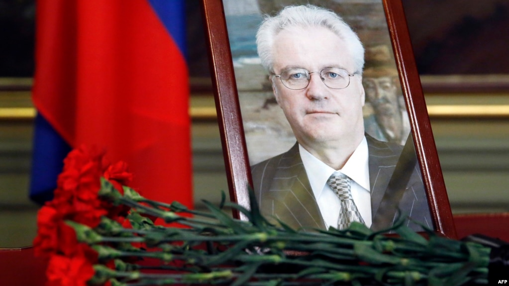Flowers are laid in front of a portrait of Russian Ambassador to the United Nations Vitaly Churkin at the Foreign Ministry guest house in Moscow on February 21. Churkin died suddenly the previous day.