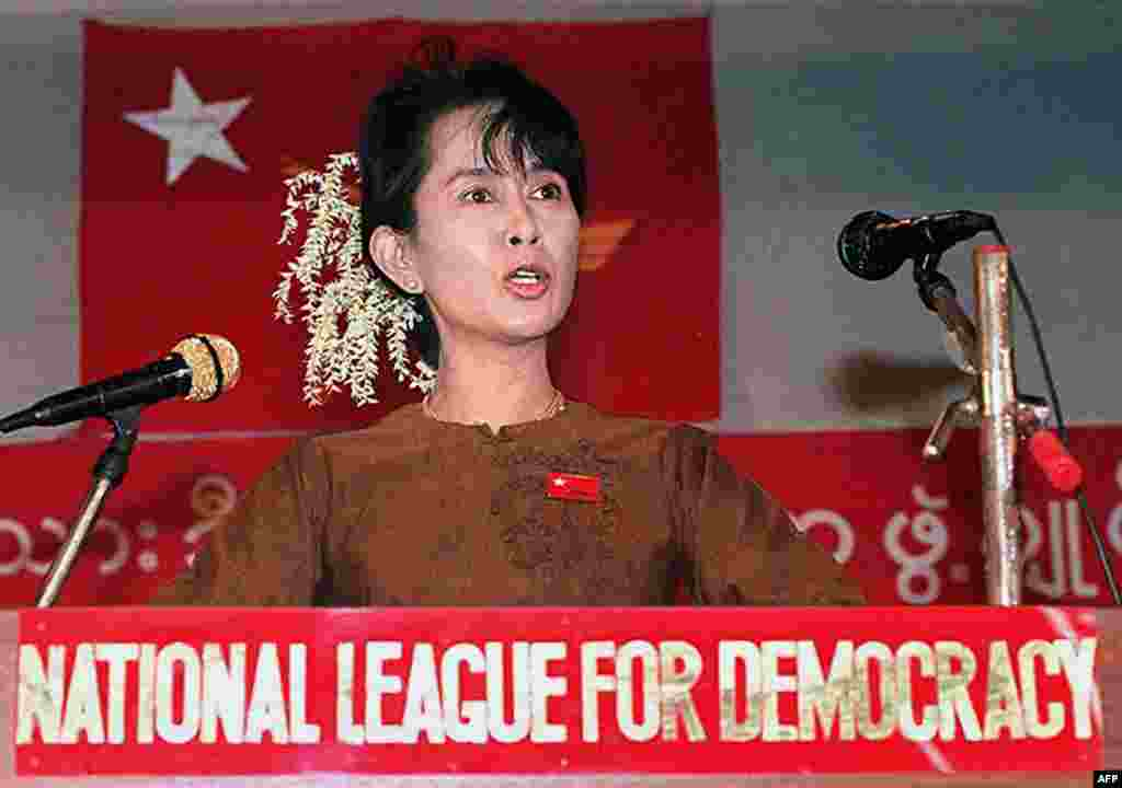 Suu Kyi addresses a gathering of supporters at her residential compound in Yangon on January 4, 1997, to mark the 49th anniversary of the country's independence movement.