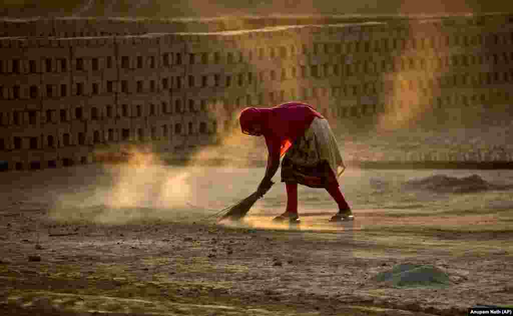 An Indian laborer sweeps at a brick kiln factory on the outskirts of Gauhati. (AP/Anupam Nath)