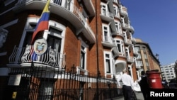 A man walks past Ecuador's embassy in London on June 20, one day after WikiLeaks' Julian Assange sought asylum there.
