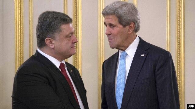 Ukrainian President Petro Poreshenko (left) greets U.S. Secretary of State John Kerry prior to their meeting in Kyiv on February 5.
