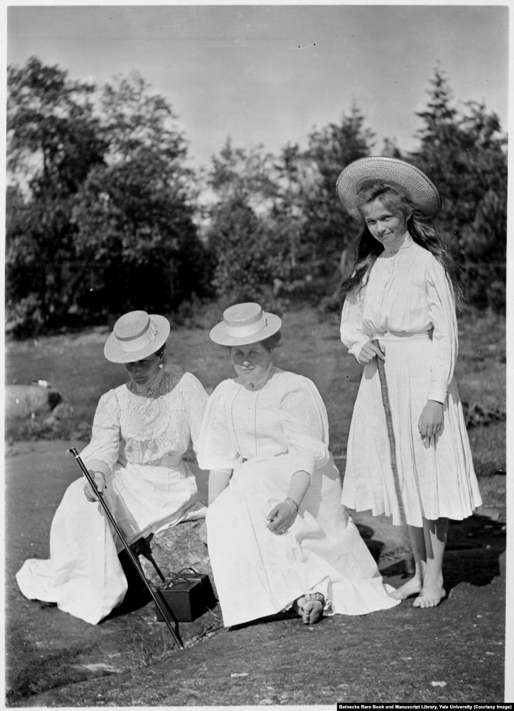 Empress Aleksandra (left) with Anna Vyrubova, and Olga, the eldest of the grand duchesses. Anna was arrested after the revolution but managed to escape to Finland with the albums, which contain more than 2,600 photographs of the private lives of the Romanovs. She died in Helsinki in 1964.