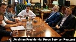 President Volodymyr Zelenskiy (in white) meets with Ihor Kolomoyskiy (in blue jacket) in Kyiv on September 10.