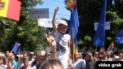 Moldova - pro-European Union supporters cheer in front of parliament in Chisinau when lawmakers approved Moldova's Association Agreements with the EU. roundup screen grab, 2 July 2014.