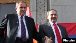 Armenia - Former President Levon Ter-Petrosian (L) and Nikol Pashinian greet supporters in Yerevan's Liberty Square, 31 May 2011.