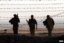 Russian troops based in Tajikistan on patrol near the Tajik-Afghan border (file photo)