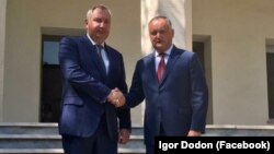 Moldovan President Igor Dodon (right) and Russian Deputy Prime Minister Dmitry Rogozin in Tehran on August 5
