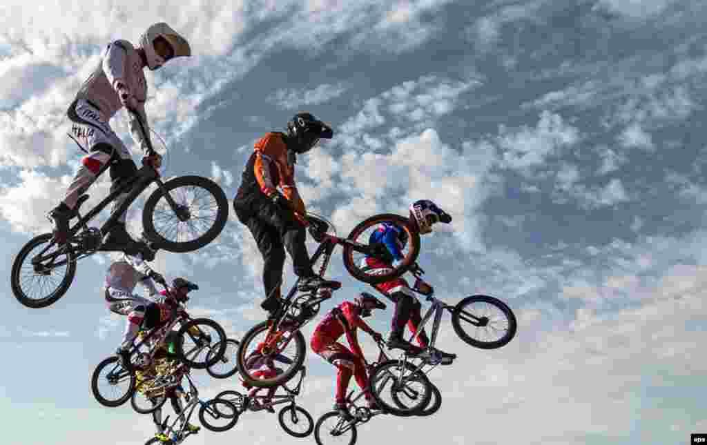 Athletes compete in the Men's BMX Motos Heats at the Baku 2015 European Games in Azerbaijan, on June 26. (epa/Bernd Thissen)