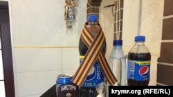 Ukraine, Crimea - Pepsi with St. George ribbon in a cafe