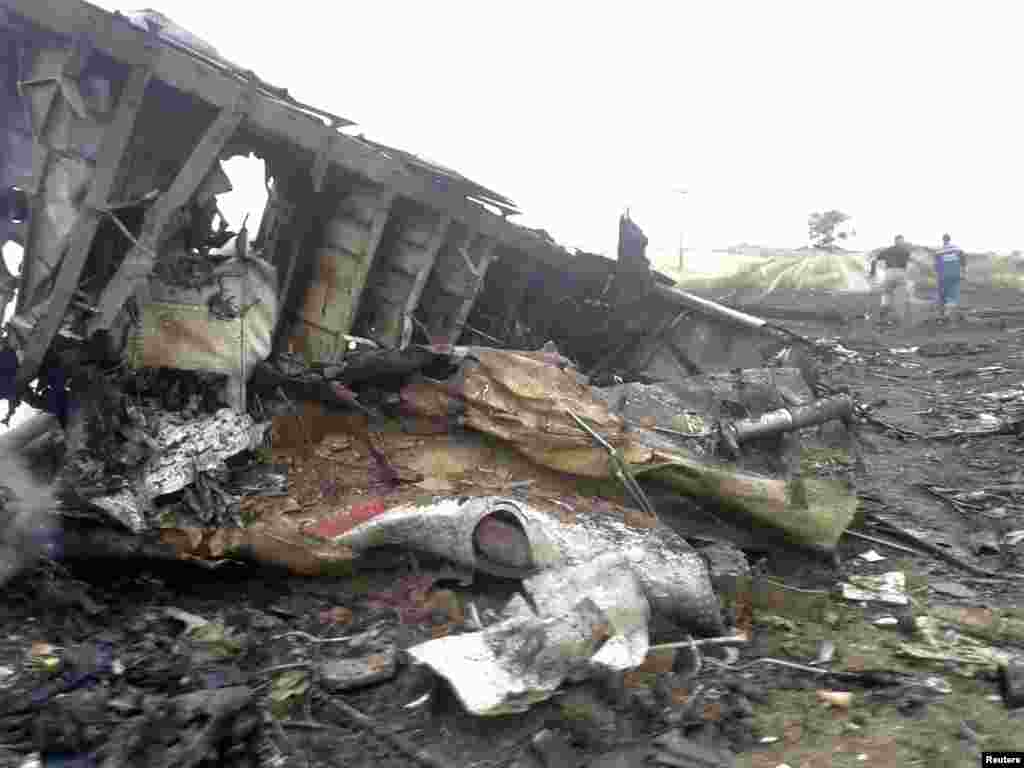 Twisted and burned wreckage of the Boeing 777 airliner.