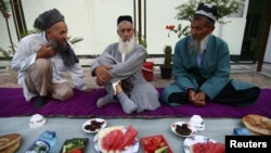 Muslim elders sit before a meal to celebrate a religious festival organised by the Islamic Renaissance Party in Dushanbe.