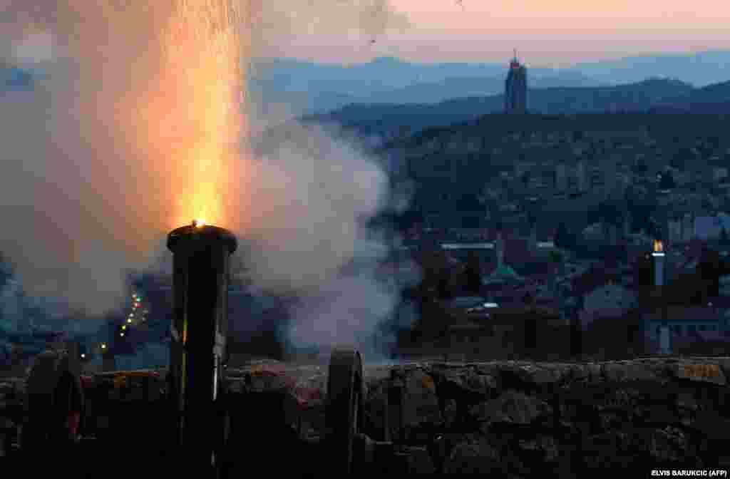 Amid a national lockdown, a cannon overlooking Sarajevo's Old Town is fired on April 23 at sunset to mark the beginning of the holy Muslim month of Ramadan in Bosnia-Herzegovina.