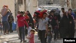 Местные жители покидают Рамади. Ирак, 15 мая 2015 года.