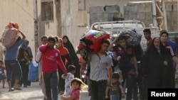 Жители Рамади покидают город, 15 мая 2015