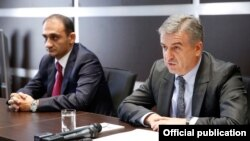 Armenia - Prime Minister Karen Karapetian (R) introduces the new head of the State Revenue Committee, Vartan Harutiunian, to senior SRC officials in Yerevan, 11Oct2016.