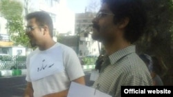"""Some of the """"starred students"""" protest in front of the Iranian state broadcaster's offices on June 7."""