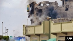 A rocket-propelled grenade rips into a building in the besieged Libyan city of Misurata.