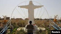 مسيحي يصلي في قراقوش
