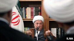 Former Iranian President and Expediency Council Chairman Ali Akbar Hashemi Rafsanjani with clerics in Qom in November.